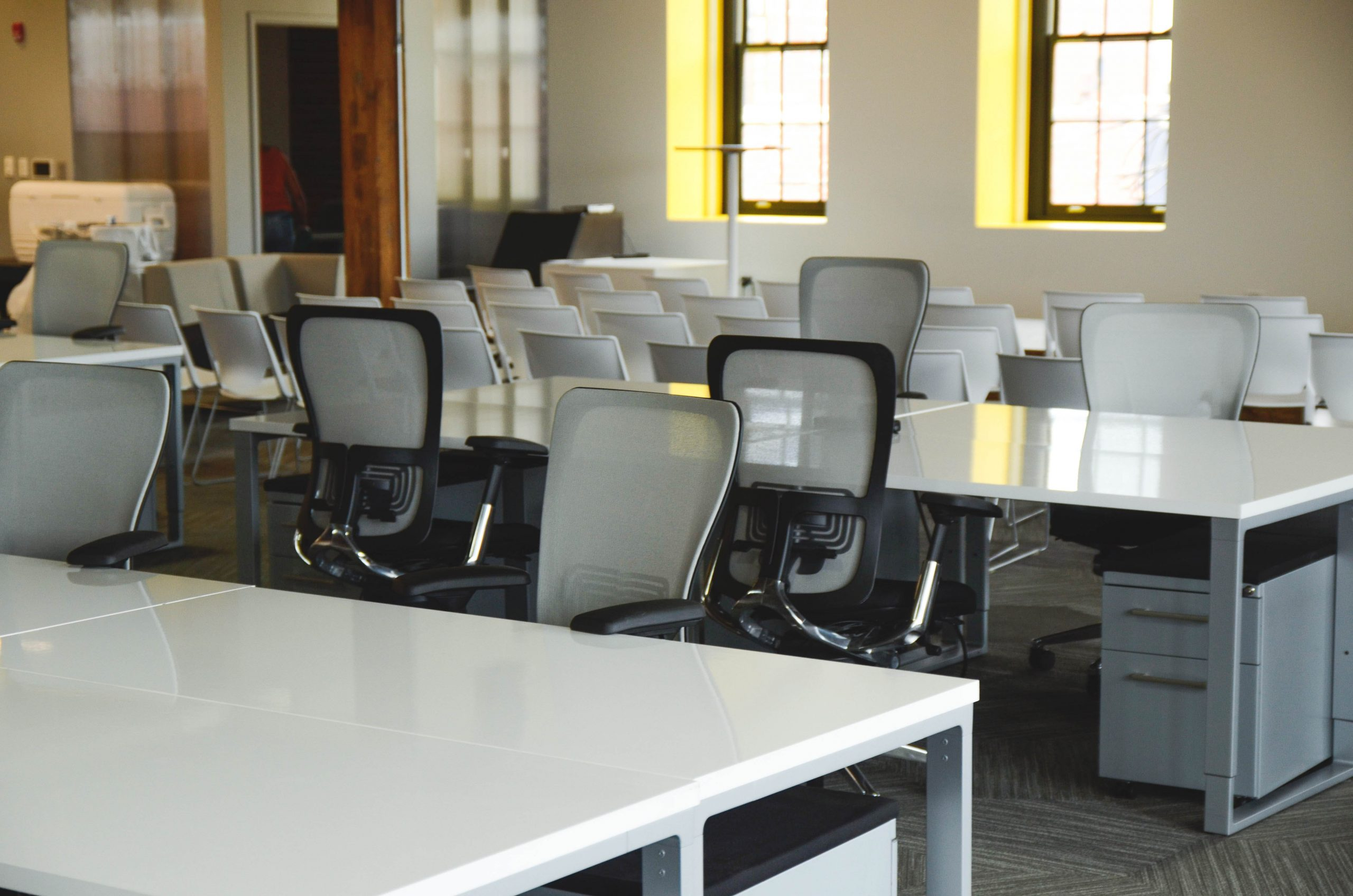 A room full of office tables and chairs