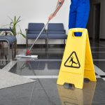 Janitorial cleaner mopping the floor