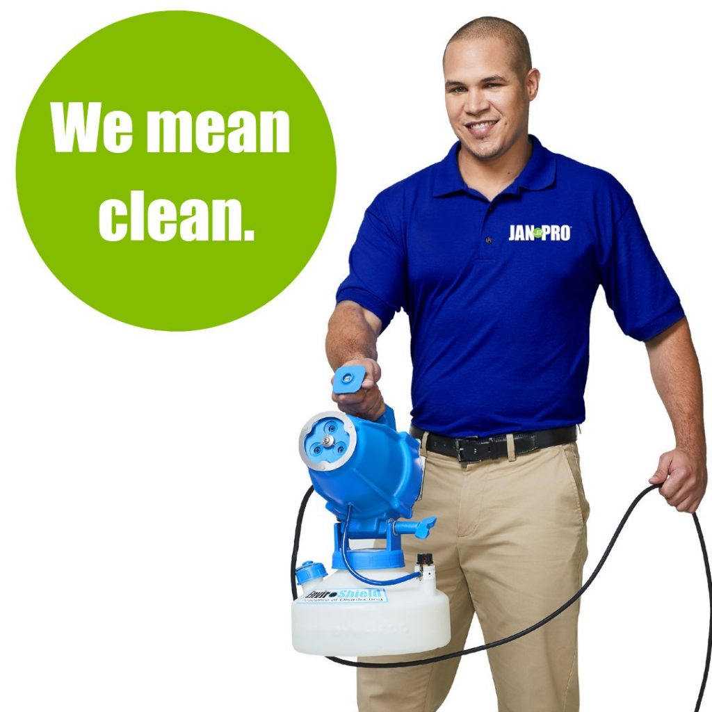 employee holding a cleaning (Enviroshield) equipment