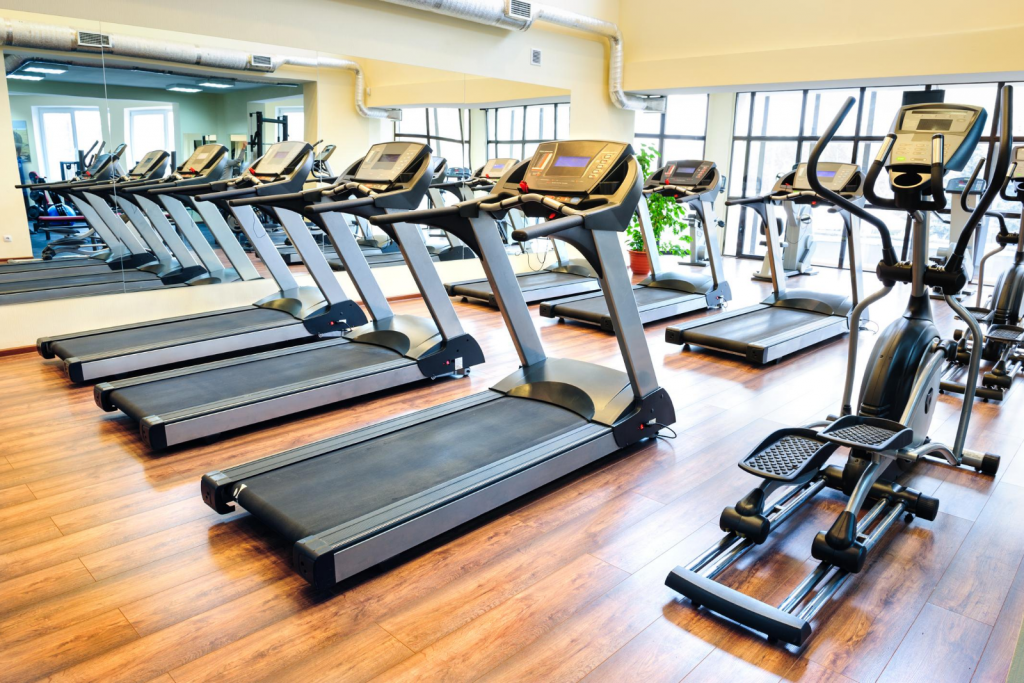 A room full of treadmill gym equipment