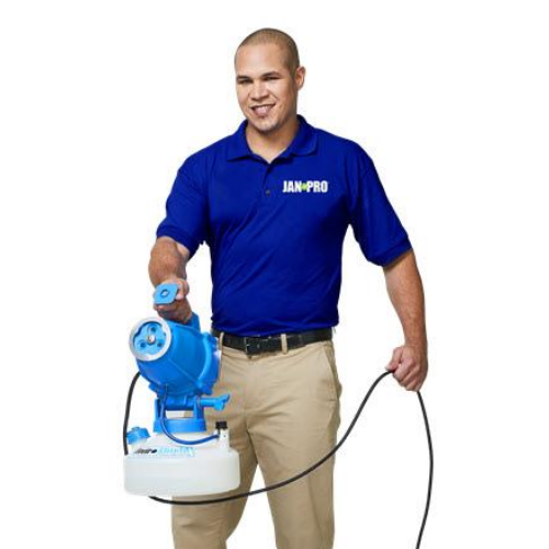 man holding cleaning equipment smiling